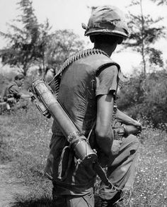 Marine carrying a LAAW (Light Anti-tank Assault Weapon). Use it once and throw it away. Used mostly against bunkers.