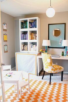 bright office/playroom.  Orange interiors.  Office.