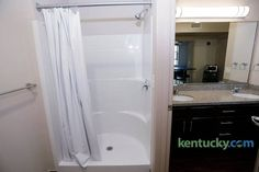 A common area with sink, bathroom and kitchen area shared by two students with individual bedrooms at Woodland Glen I, a new dorm on the University of Kentucky campus across from the W.Young Library in Lexington, Ky. Photo by Pablo Alcala University Of Kentucky Campus, University Dorms, University Logo, Kentucky Basketball, Duke Basketball, Kentucky Wildcats, College Basketball, Basketball Players, Dorm Bathroom