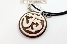 Yoga Gift Polymer Clay Pendant «Om» / «Ohm» / «Aum». Handmade sanskrit sign on brown base. Unique gift for her. Best present for him by SweetyBijou on Etsy