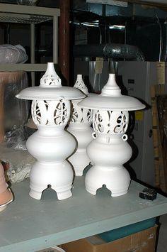 bisque fired porcelain lanterns awaiting glaze firing...