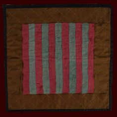 """Lancaster County, Pennsylvania, c. 1925, unknown maker. Amish babies were welcomed with quilts, usually made by their mothers or grandmothers. Today Amish crib or doll quilts are quite rare because they were put to hard use. This one was never used therefore it had to have been deliberately saved by the quilt maker. Pieced wools, good condition. 15"""" x 15""""."""