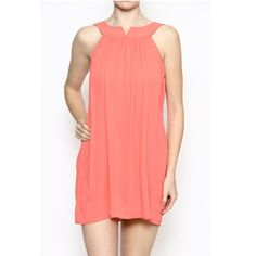 "Sleeveless Coral Chiffon Dress Solid sleeveless chiffon dress. Lined. Body length: 30"". 100% polyester. Dresses"