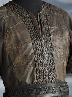 "Even leather vests get detailed by Bergin's costume crew. This garment worn by Ragnar is intricately woven, braided, aged and distressed to look as if it has survived quite a few Viking raids on The History Channel's new series, ""The Vikings"""