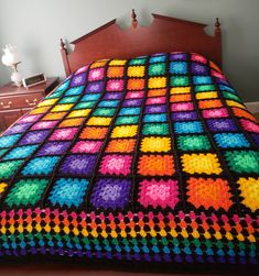 Brighten any room with this beautiful multicolored granny square blanket! Made with acrylic yarn that is machine washable and dryable. Large enough to cover a queen-sized bed Scrap Crochet, Crochet Quilt, Diy Crochet, Crochet Crafts, Crochet Baby, Crochet Projects, Crochet Bedspread Pattern, Granny Square Crochet Pattern, Afghan Crochet Patterns