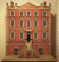 A miniature Classical house in the early eighteenth-century period style with the perfect proportions of that time. The double staircase leading to the raised floor, the pedimented roof and the external balustrade all proclaim this an example of one of the great periods of architecture.