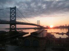 Sunset over the Jersey River and the Benjamin Franklin Bridge in Philadelphia.
