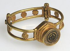 Gold and Niello Bracelet   5th–6th C. possibly Syria   Byzantine.  Gold, niello.  2 3/8 x 2 3/8 x 7/8 in.