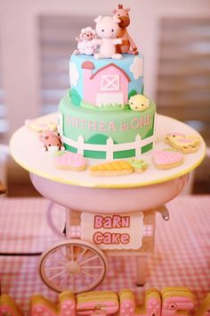 Pink Barnyard Birthday Cake via Kara's Party Ideas | Party ideas, supplies, tutorials, recipes, games, favors and more! KarasPartyIdeas.com