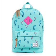 NWT Flamingo Backpack by Herschel Brand new darling flamingo print backpack with an aqua blue background.  Made by Herschel.  This is a smaller size and is ideal for a child.  Part of the Heritage Kids collection.  Please see the measurements in the 3rd photo for size info.   I bought this to go with a coordinating fun animal printed ModCloth summer dress but ended up using a different bag.  My loss is your gain!! Herschel Supply Company Accessories