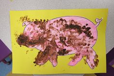 "Muddy Pigs! Mix sand, oatmeal, and brown paint to make ""mud."" Then let the kids spread it on their piggies!"