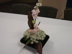 Custom design with ti-leaf, Queen Ann's Lace and Pink Larkspur.