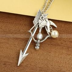 Mockingjay necklace with Katniss Arrow and Bow with  by luckyvicky