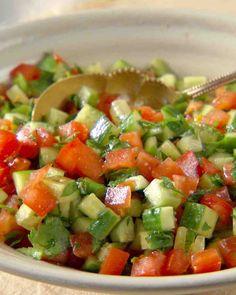 Israeli Salad - cucumbers, tomatoes, onions, parsley, lemon, olive oil, salt and pepper (minus the mint leaves)