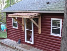 Building a Front Porch Roof with Metal Cover : Fabulous Small Front Porch Decoration Using Maroon Wood Siding Front Porch Wall Including Small Rustic Solid Wood Building A Front Porch Roof And Single White Wood Glass Front Doors Front Door Overhang, Front Door Awning, Porch Awning, Diy Awning, Roof Overhang, Porch Roof, Window Awnings, Shed Roof, Glass Front Door
