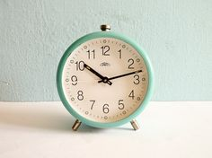 Vintage turquoise mechanical alarm clock working by EuroVintage