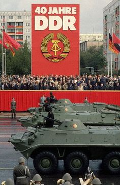 East German Army BTR-70 armored personnel carriers rolling down Karl-Marx-Allee in the 1989 Republic Day Parade (40th Anniversary of the DDR).