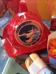 Fun fireman hat favor at a Disney plane boy birthday party!  See more party ideas at CatchMyParty.com!
