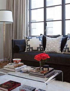 lucite coffee table + Ryan studio fretwork pillows