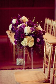 tall vases with these flowers down the aisle