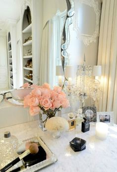 What a pretty set up! Love the white counter and pink roses! Now let's just replace the makeup...