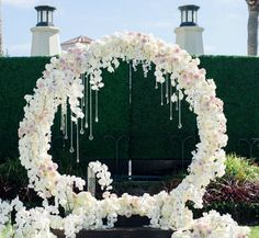 A floral arch with hanging crystals would beautifully frame a couple at the altar ~ Blush Botanicals
