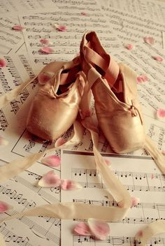 pointe shoes and music sheets <3 two of my faves things :) my flute and dance. I really want pointe shoes!