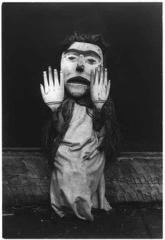 """Kwakiutl wearing an oversize mask and hands representing a forest spirit, Nuhlimkilaka, (""""bringer of confusion"""")"""