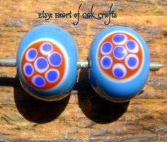 This style of bead (turquoise or blue base with reddish roundels filled with blue and white dots) was originally produced on the Continent in Irish Clothing, Viking Glass, Lampwork Beads, Cornwall, Beading Patterns, Britain, Roman, Glass Beads, Ethnic