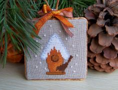 Cross stitched Christmas decoration.