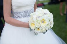 White wedding bouquet with rhinestone brooches