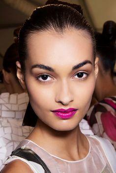 Glossy magenta statement lips + matte skin