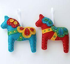 Dala Horse Felt Ornaments Plush Set of 2 Teal Red Christmas Swedish Cute Ornament. $24.00, via Etsy.