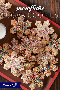 These Snowflake Sugar Cookies are a colorful, unique twist on typical holiday sugar cookies! Line your baking sheet with Reynolds Parchment Paper, available in rolls or pre-cut sheets, for cookies that don't stick and fast, easy cleanup!