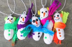 DIY Christmas ornaments for kids. This photo shows peanuts painted white to look like snowmen. There's more good ideas on this site. - via RedTricycle.