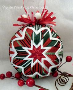 OMG, this etsy shop owner makes these ornaments using that folded potholder method that I've seen. I can't imagine the patience this would take!