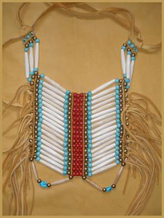 Native American influenced Breast plate choker.. $136.40, via Etsy.