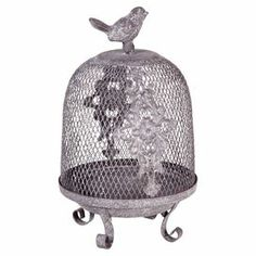 """Openwork iron birdcage decor with scrolling legs.   Product: Birdcage decor Construction Material: Iron Color: Silver Dimensions: 10.75"""" H Cleaning and Care: Wipe with damp cloth"""