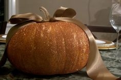 Glittery pumpkin centerpiece and apple candle holders
