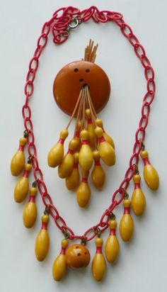 bakelite bowling necklace & brooch