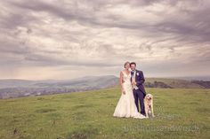 Bride & Groom with Dog & Incredible Sky at Wedding. Photography by one thousand words wedding photographers