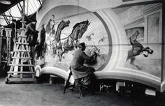 Orton and Spooner artists work on a chariot scene front.