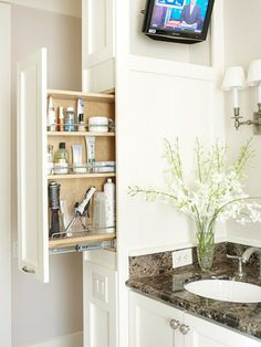 30 Ways to Store More in Your Bath: I like the way those outlets are done, & would LOVE a tiny bathroom tv like that!!