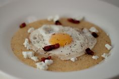 Polenta with Fried Egg, Pancetta, and Goat Cheese.