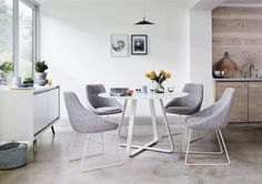 Great value modern white round glass and steel table seats 4, perfect for the kitchen. With a durable, toughened glass top.