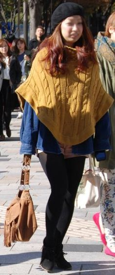 cable knit poncho and beret spotted in harajuku streets fashion