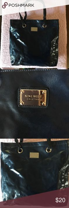Nine West purse navy tote This purse is in excellent condition. It is shinny navy and is a  Nine West tote purse. Nine West Bags Totes