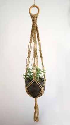 This item is unavailable Macrame Plant Hanger / 28 Inch / Twine / Macrame by MangoAndMore Macrame Plant Hanger Patterns, Macrame Plant Hangers, Macrame Patterns, Craft Patterns, Macrame Art, Macrame Projects, Macrame Knots, Diy Hanging Planter, Hanging Plants