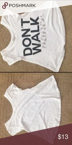 """Don't Walk, Dance Tee Shirt For Girls Don't Walk, Dance Tee Shirt for girls. Plain white tee shirt with """"Don't walk, Dance"""" written on the front in black and sliver letters. Sorry the pictures are sideways😬 Nordstrom Shirts & Tops Tees - Short Sleeve"""