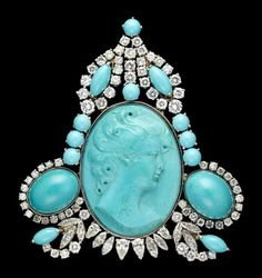 Persian turqouise and diamond brooch Turquoise cameo framed by turquoise cabochons accented by petite marquise and round cut diamonds set in platinum, can be worn as a brooch or as a pendant. Total carat weight apparoximately 5.5 carats.
